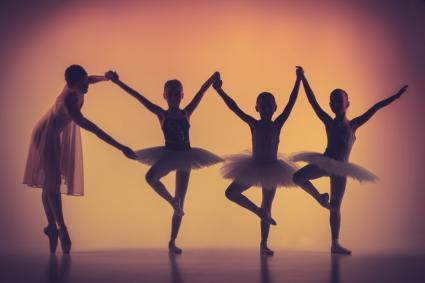 Ballerinas dancing with teacher