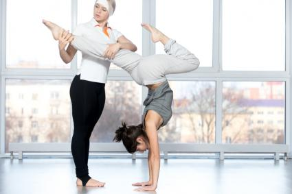 Dance teacher helping student