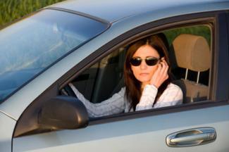 Woman talking on phone in car