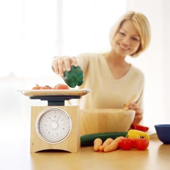 Woman weighing food