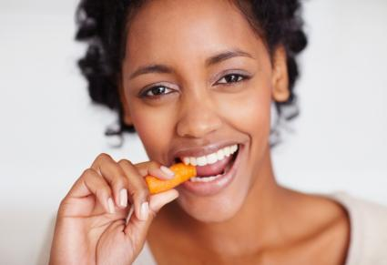 woman eating carrot stick