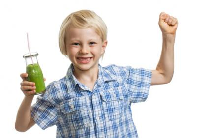 Boy with green smoothie