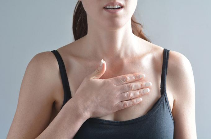 Woman feeling heart palpitation