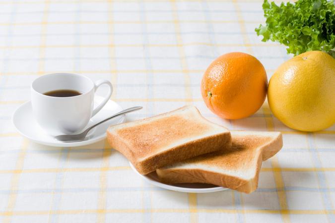 Coffee, toast, and fruit breakfast