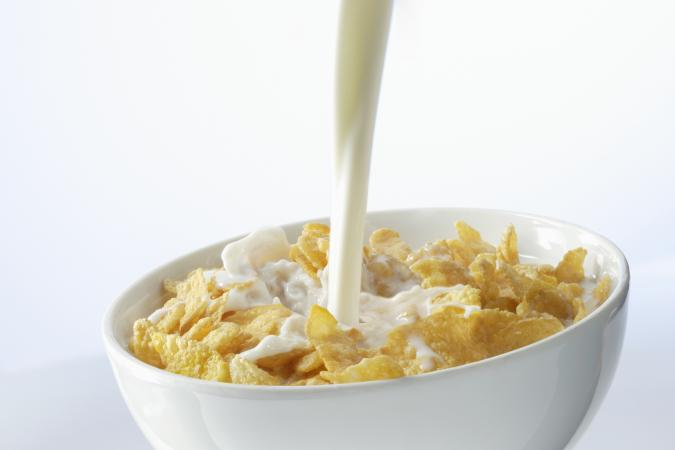 pouring milk on cereal