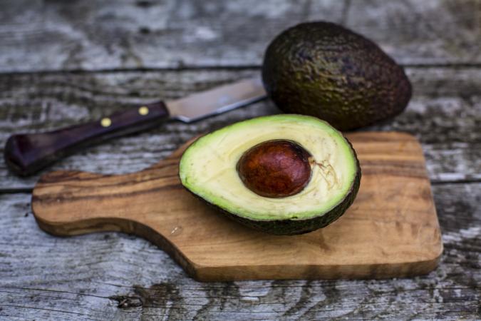 Avocado on chopping board