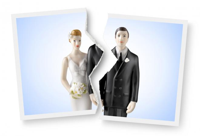 Torn photograph of wedding cake topper