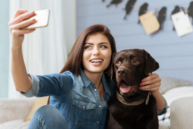 Lady and her dog posing for a photo