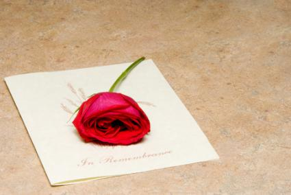 Funeral program for a loved one; copyright © Robert Byron at Dreamstime.com