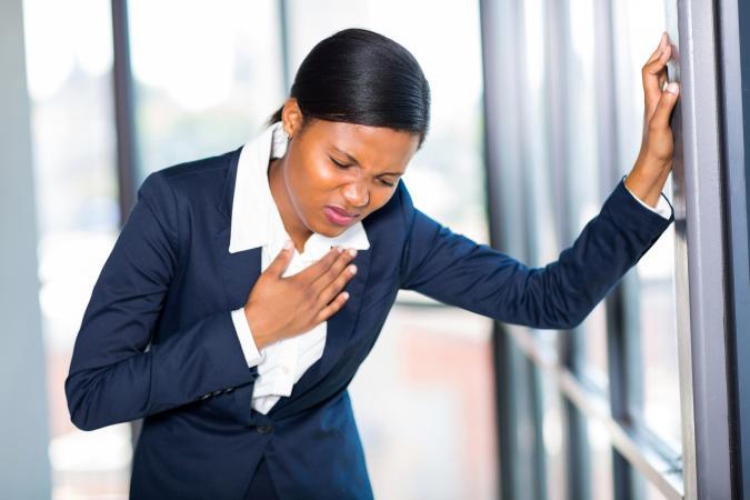 Businesswoman having heart attack