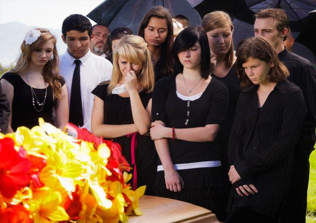 Grieving teenagers at funeral