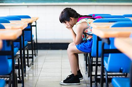 Grieving girl in classroom