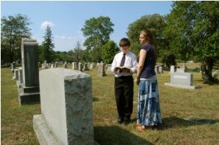 Couple of children mourning at grave
