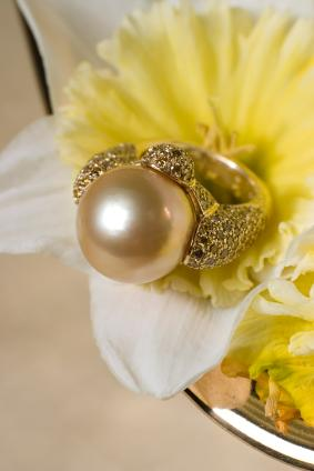 Yellow pearl engagement ring