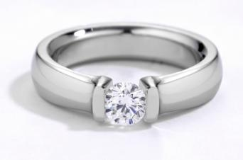 Engagement ring with tension setting