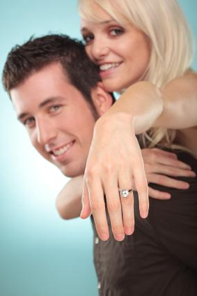 Couple showing off the ring