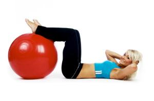 Woman working out with exercise ball.