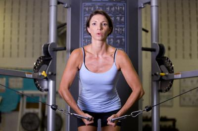 Woman doing cable crossover flyes