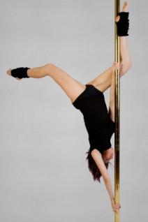 Woman exercising on pole.