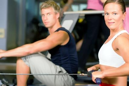 Couple on rowing machines