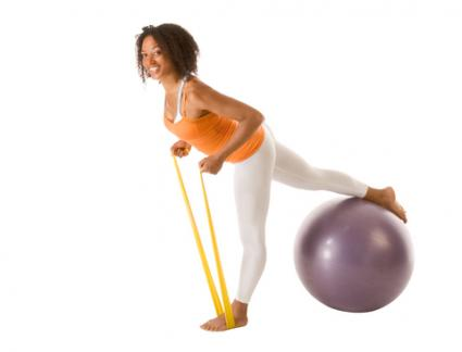 woman exercising with resistance band