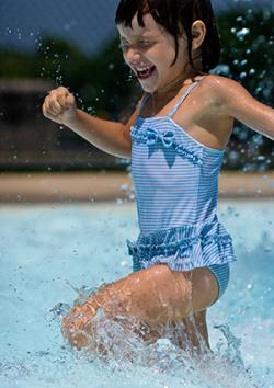 Girl jogs in place in pool