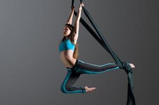 Girl performing aerial silk dance