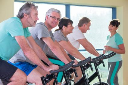 Group of seniors using spinning bikes