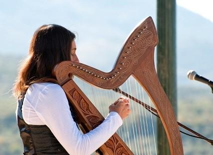 Woman playing Irish harp