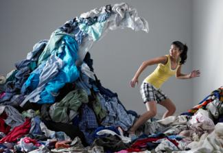 woman under wave of laundry