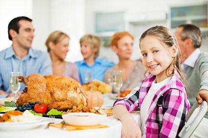 Girl with family at Thanksgiving