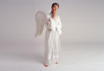 Man in angel outfit, pondering