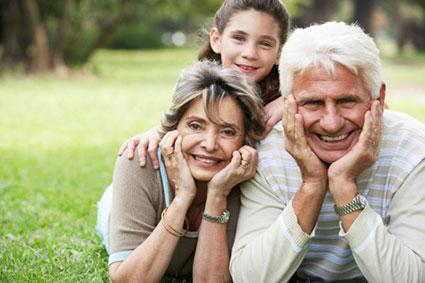 Young girl in park with grandparents