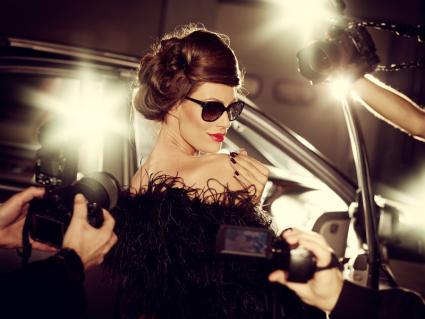 Glamorous Celebrity Surrounded By Paparazzi