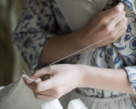 colonial girl sewing