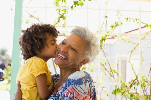 Grandmother and granddaughter embracing