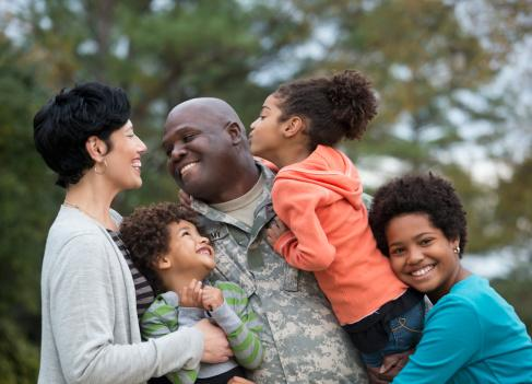 Family greeting returning soldier