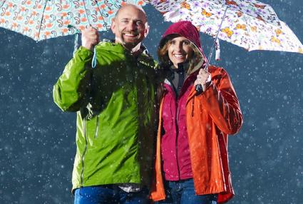 Man and woman wearing raincoats