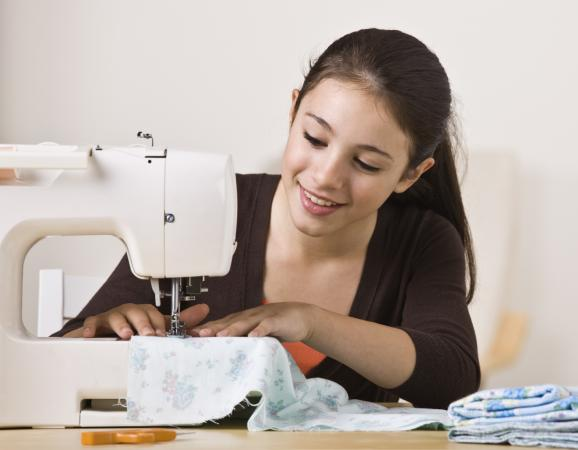 Young Girl Sewing
