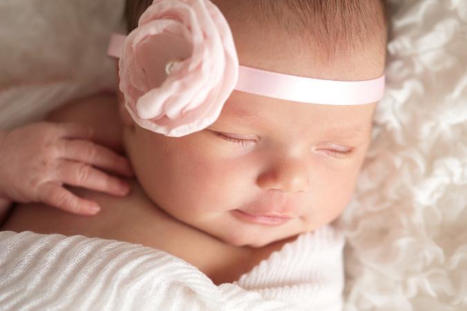 Baby girl with pink headband