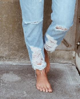 Woman wearing torn jeans