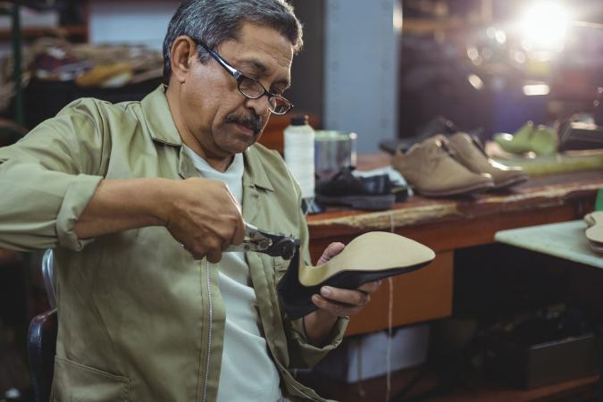 Shoemaker making a shoe