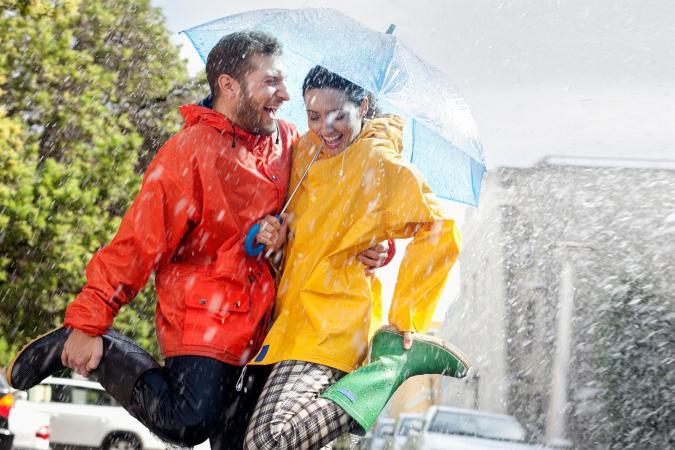 Happy couple in rainy street