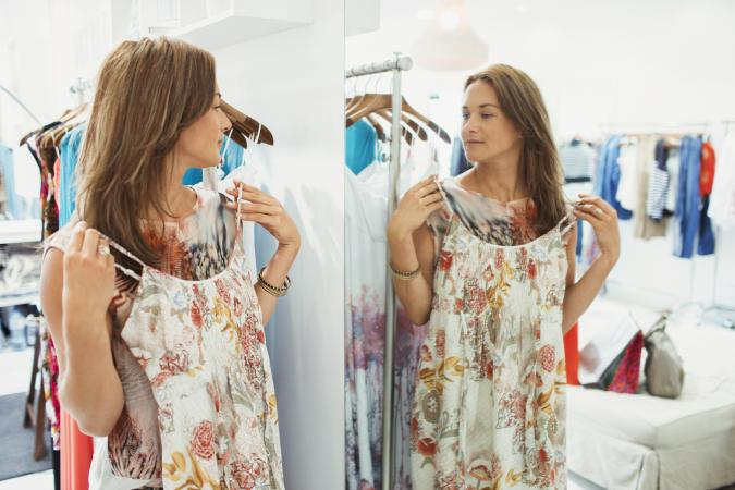 Woman admiring dress in store