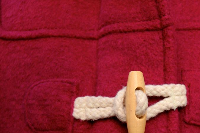 Close-up of red duffel overcoat