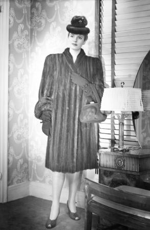 Fashionable woman in mink coat and hat