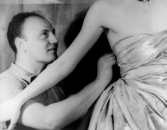 Pierre Balmain fitting haute couture gown on actress Ruth Ford.