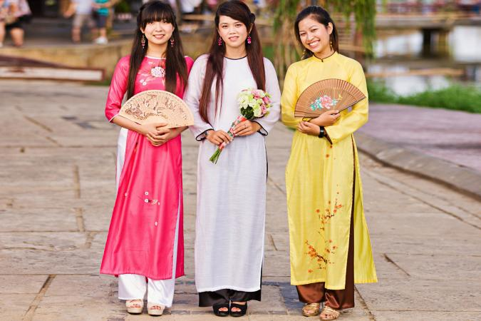 Three women wearing ao dai