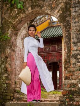 Woman wearing ao dai dress in Hue, Vietnam