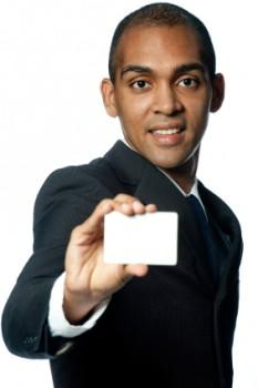 Man holding blank business card.